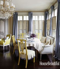 Designer Kelee Katillac dressed up her stripped-down apartment in a 1915 Kansas City, Missouri, building with neoclassical moldings, crystal chandeliers, silk curtains, and furniture from her forthcoming Kelee Katillac Couture Collection. The living room's Emma side chair is based on a vintage Henredon design.