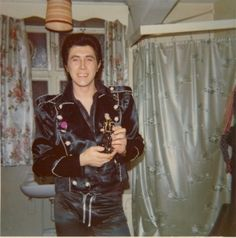 Bryan Ferry posing with a doll in his likeness, in the dressing-room of the Liverpool Empire, April 5, 1973, during the For Your Pleasure tour.