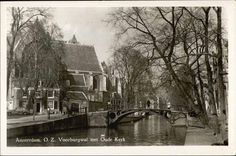 1940's. View on the Oude Kerk and Oudezijds Voorburgwal. In the center the Oudekerksbrug. The 800-year-old Oude Kerk is Amsterdam's oldest building and oldest parish church, founded ca. 1213 and consecrated in 1306 by the bishop of Utrecht with Saint Nicolas as its patron saint. The church is located at the Oudekerksplein. The square is wedged between the Warmoesstraat and Oudezijds Voorburgwal canal. #amsterdam #1940 #Oudekerk #OudezijdsVoorburgwal