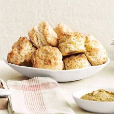 Cheddar Biscuits. Serve these biscuits with Sweet-and-Spicy Cola-Glazed Ham and store-bought chutneys and mustards for a savory brunch or hearty dinner.