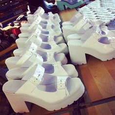 Rachel in white re-order in the factory floor waiting for the leather Miista branded insole to be attached before being packed #miistaproductionspain #ss14 They will be back at Miista.com by Wednesday!