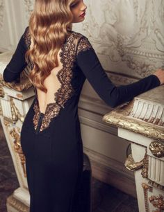 Beautiful backless gown  also like her hair