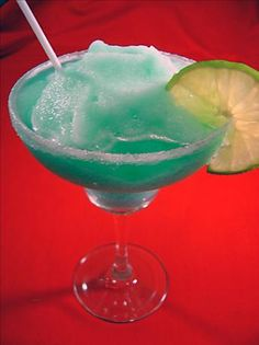 Blue Lagoon Margarita | 1 1/4 ounces tequila 3/4 ounce blue curacao 1 1/2 ounces lime juice 2 ounces prepared sweet-and-sour mix 1 1/2 ounces pineapple juice 2 cups crushed ice 1 lime wedge granulated sugar Directions: 1 Rub rim of margarita glass with lime wedge and dip in granulated sugar. 2 Process tequila, blue Curacao, lime juice, sweet and sour mix, pineapple juice, and ice in blender until smooth. 3 Pour into margarita glass.