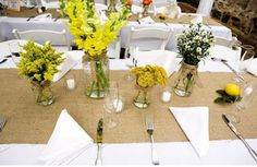 burlap runners with vintage bottles and flowers