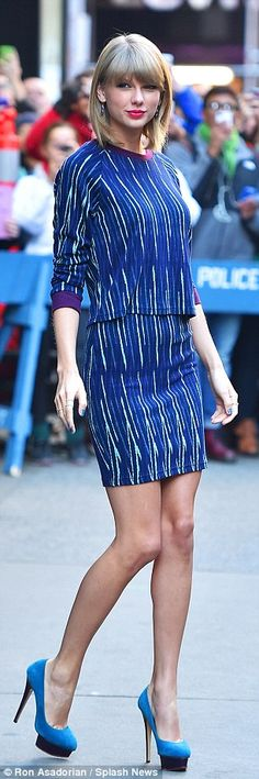 Like a model: Taylor showed off her toned legs in a short blue number as she left the GMA studios