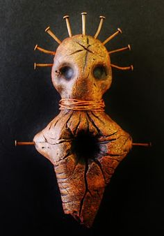 Hoodoo Magick Rootwork:  A Voodoo doll with nails.