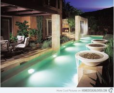 A modern pool area with features that certainly made it appear more inviting. The seating area near it is perfectly situated to give the users a calming ambience.