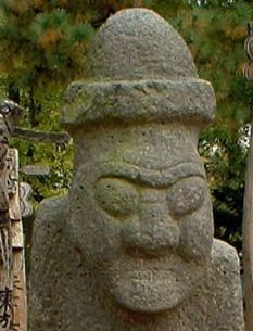 """Dol hareubang - Because of the relative isolation of the island, the people of Jeju have developed a culture and language that are distinct from those of mainland Korea. Jeju is home to thousands of local legends. Perhaps the most distinct cultural artifact is the ubiquitous dol hareubang (""""stone grandfather"""") carved from a block of basalt."""
