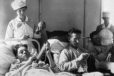 Bed-ridden wounded knit to help pass the time. Walter Reed Hospital, Washington, DC, ca. 1918-1919.