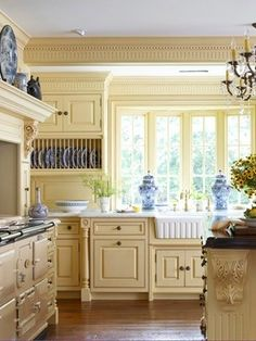 Pale Yellow Kitchen Cabinets Kissed With Blue