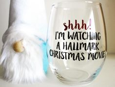 The new wine glass posing with our cute gnome. Hes a DIY project. Anyone want to know how we made him?! Or want us to make it for you?  #gnomes #hallmarkchristmasmovies #holidayseason