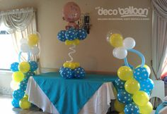 Balloon columns and centerpiece.  See the pacifiers?