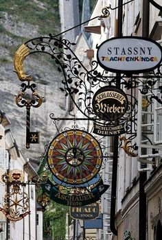 Historic Old Town Lane With Wrought-iron Shop Signs,Getreidegasse Alley,Salzburg,Austria,Europe Stock Photos / Pictures / Photography / Royalty Free Images at Inmagine Storefront Signs, Pub Vintage, Pub Signs, Shop Fronts, Business Signs, Store Signs, Advertising Signs, Hanging Signs, Belle Photo