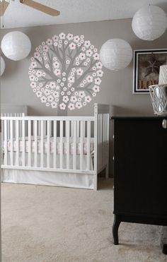 Love the grey walls, white crib and neutral carpet.  Perfect if your not finding out gender. After baby is born start accenting with color :)