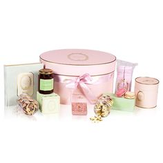 Versailles Hamper - This luxurious case contains a wealth of sweets and gourmandises: macarons, chocolates, tea, jam, batons de maréchaux, meringues, marshmallows and a book of sweet recipes.