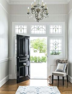 Black doors made for a bold entrance to a Queenslander home. Here are some of the best looking black doors that you will find! Decor, Home, Foyer Decorating, House Inspiration, House Entrance, Interior, New Homes, House, House Interior