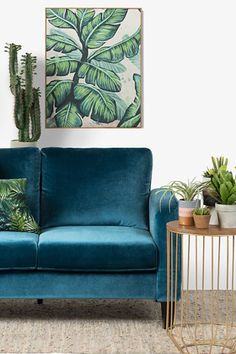 Add texture to your living room with unique furniture pieces. This plush, velvety 2-seat sofa is perfect for a relaxing evening.