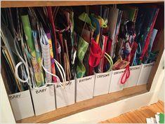 Gift bag storage using IKEA magazine holders. - Ikea DIY - The best IKEA hacks all in one place Ikea Organisation, Organization Station, Office Organization, Gift Bag Organization, Organizing Gift Bags, Organization Ideas, Organizing Tips, Gift Bag Storage, Craft Storage