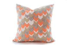 LAST ONE. Chevron pillow cover in luscious soft orange and taupe. This print has a slight twist to the popular chevron print. Medium weight decorator cotton duck. Pattern BOTH sides.  Features: -invisible zipper at bottom edge for easy on and off. -serged seams and tapered corners for professional fit.  Made by me with care in my Vancouver studio. Recommend drycleaning. Spot clean with damp cloth. Please allow 6 business days for your order to be made and shipped.  >>>Pillow insert not…