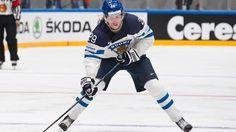 Patrik Laine   http://yle.fi/uutiset/young_hockey_talent_patrik_laine_praised_worldwide_after_mens_championship_opener/8865600