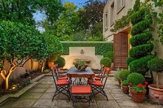 Beautiful.This just invites one to dine alfresco. Topiary trees, stone, the fountain all very nice. Mediterranean Gardens _dig that garden design
