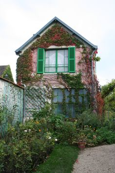 Sideview of Orm's house~~Pink stucco----as head gardener he obviously has a neat garden