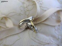 http://www.lemienozze.it/operatori-matrimonio/gioielli/stefano-andolfi/media  Fedi nuziali con fasce intrecciate