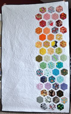 "gorgeous. . . but this also appeals to the lazy quilter in me--it's a design choice, not a ""I didn't want to make one more hexagon"" choice. . . i swear."