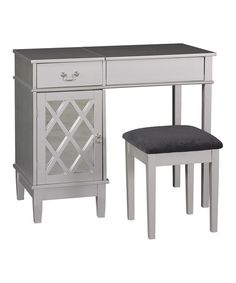 Elegantly organize and apply cosmetics with this stylish vanity. Equipped with a large hidden mirror and matching seat, it creates a chic and serene place for all those personal grooming needs.