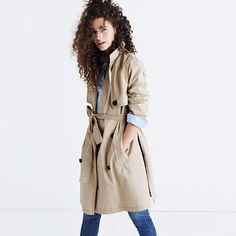 Medal - A rethink of the timeless trench designed with styling in mind: High slits up each side show off a cool dress underneath, a popping-friendly collar has trapunto stitching on the flip side and the sash belt ties to the front or to the back.