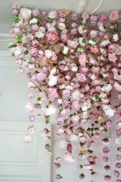 Falling flowers incorporated into installation over bridal table