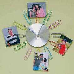 """Paperclip Clock      Add a fanciful splash of whimsy to your home or office wall with this paperclip wall clock. Insert photos into the clips for a changing display of family and friends. Takes 1 AA battery, not included. 15½"""" dia."""