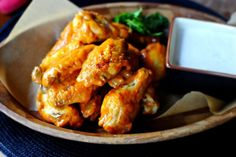 The more sauce you toss the raw wings in the spicier they will be. Use the blue cheese dip to cool things down. (via Simply Scratch)