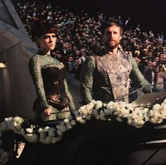 District 7 tributes>>> Johanna just looks so done with everything, and Blight looks like he wants to smile and wave and everything, but he's scared that if he does Johanna will murder him.