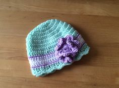 Mint green and purple crochet baby hat by LoveSewSweetBoutique