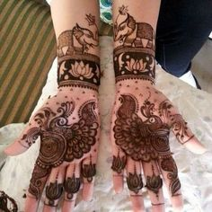 Nowadays brides try Wedding Mehndi Designs with different motifs. As a result elephant styled wedding mehndi designs really looks gorgeous. Peacock Mehndi Designs, Latest Bridal Mehndi Designs, Indian Mehndi Designs, Henna Art Designs, Wedding Mehndi Designs, Unique Mehndi Designs, Beautiful Mehndi Design, Mehandi Designs, Wedding Henna