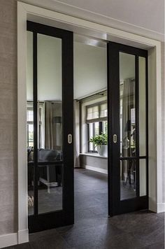 Pocket doors or sliding doors with black trim to offset the rest of the white trim and white fireplace. House Design, Door Design, French Pocket Doors, House, Interior, Home, Sliding Doors Interior, Doors Interior, House Interior