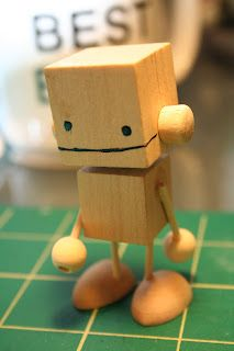 No metal required. A cute wooden robot.