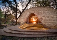 The African armadillo influenced the curved, scale-covered form of this boutique safari lodge in Botswana