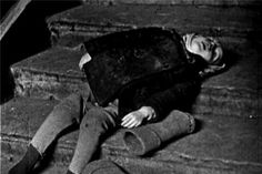 The hunger was especially tough on 400,000 children who got stuck in the blockade. Photo: a child collapsed and died on the stairs of her home (Leningrad, 1942)