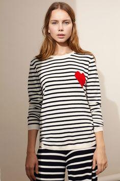 A feel-good take on the timeless Breton, this relaxed fit cream and navy striped cashmere sweater features a heart intarsia.