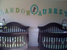 Adorable twins nursery with DIY letters to customize who's crib