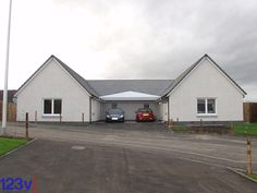 Double carport to suit house design. Snow load had to be calculated to infill house roofs. Fitted Dundee Scotland UK.