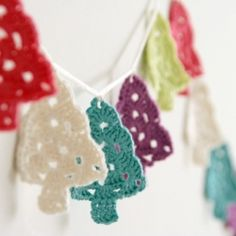 Colorful crochet trees garland, perfect for a handmade christmas.