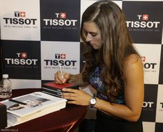 Danica spends time talking to fans and signing autographs during the celebration of her 10th anniversary as Tissot Ambassador, Indianapolis, 7/25/15. (HHP/Harold Hinson)