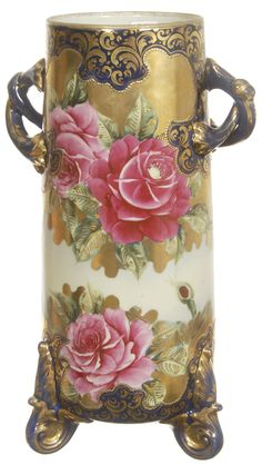 Hand Painted Rose Vase; I just expect it to start singing! Too many Disney movies, I guess! It is beautiful. kn