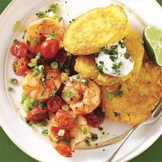 Soft corn cakes topped with shrimp in a savory tomato and white wine sauce in this easy enough for a casual meal but special enough for company dish.