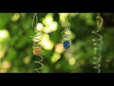 This easy-to-make garden decoration spins in the wind, creating a mesmerizing optical illusion where it looks as if the marble is spinning up and down the wire coil surrounding it. I love to hang these in the garden because they bring interest and movement, and they dance and sparkle beautifully in the sun.