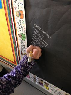 Graffiti Board~Black butcher paper and metallic sharpies...kids here are writing quotes from books they've read. You could also have kids write character names and personality traits.
