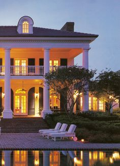 this house makes me drool. White with black shutters? big front porch? columns??? pool?? This is my dream!
